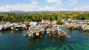 Fishing Village With Wooden Houses On Stilts In The Sea. Village