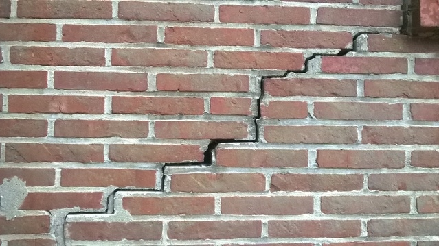 help  there are cracks in the brickwork